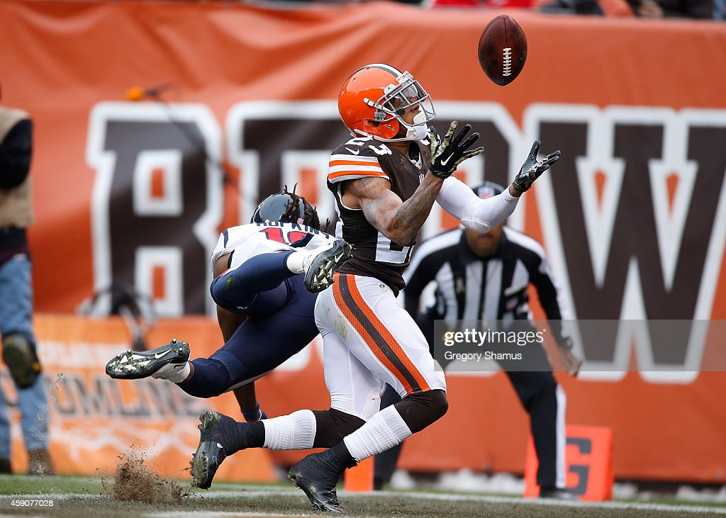 Joe Haden #23 of the Cleveland Browns intercepts a pass intended or DeAndre Hopkins #10 of the Houston Texans during the first quarter at FirstEnergy Stadium on November 16, 2014 in Cleveland, Ohio.
