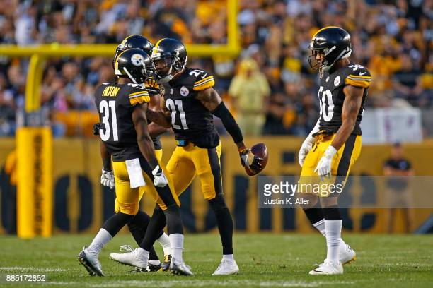 Joe Haden of the Pittsburgh Steelers celebrates with Mike Hilton after intercepting a pass thrown by Andy Dalton of the Cincinnati Bengals in the...
