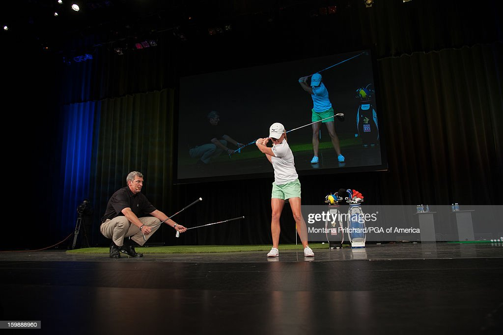Joe Hallett (L) and LPGA Player of the Year <a gi-track='captionPersonalityLinkClicked' href=/galleries/search?phrase=Stacy+Lewis+-+Golfer&family=editorial&specificpeople=4217318 ng-click='$event.stopPropagation()'>Stacy Lewis</a> give a demo at the 'Coaches & Relationships: Combining the Elements for a Championship Performance' lecture during the 13th PGA Teaching and Coaching Summit held at the Orange County Convention Center on January 22, 2013 in Orlando, Florida.