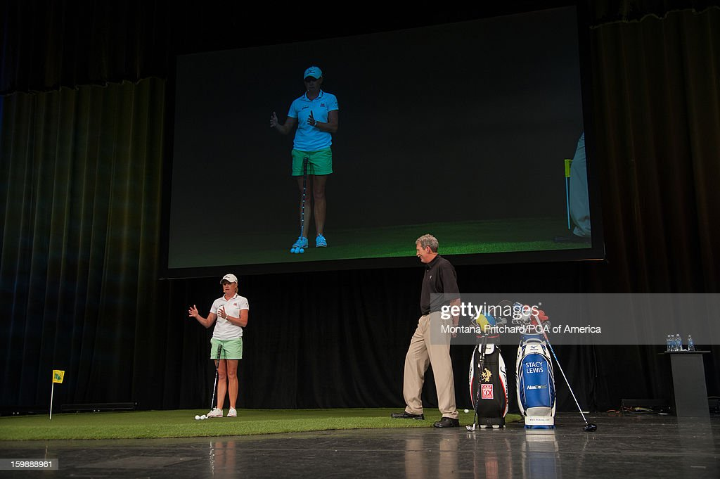 Joe Hallett (R) and LPGA Player of the Year <a gi-track='captionPersonalityLinkClicked' href=/galleries/search?phrase=Stacy+Lewis+-+Golfer&family=editorial&specificpeople=4217318 ng-click='$event.stopPropagation()'>Stacy Lewis</a> give a demo at the 'Coaches & Relationships: Combining the Elements for a Championship Performance' lecture during the 13th PGA Teaching and Coaching Summit held at the Orange County Convention Center on January 22, 2013 in Orlando, Florida.