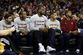 Joe Harris James Jones LeBron James Jared Cunningham and Tristan Thompson of the Cleveland Cavaliers watch from the bench against the Oklahoma City...