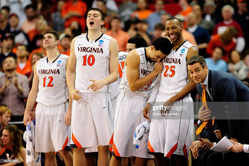 Joe Harris Mike Tobey Anthony Gill Akil Mitchell and head coach Tony Bennett of the Virginia Cavaliers react late in the game against the Memphis...