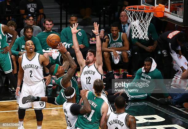 Joe Harris of Brooklyn Nets in action against Isaiah Thomas of Boston Celtic during the NBA match between Brooklyn Nets and Boston Celtics at the...