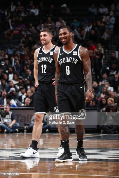 Joe Harris of the Brooklyn Nets and Sean Kilpatrick of the Brooklyn Nets react during the game against the Denver Nuggets on October 29 2017 at...
