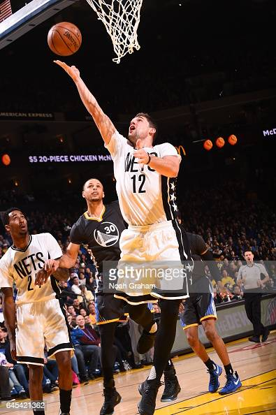 Joe Harris of the Brooklyn Nets goes to the basket against the Golden State Warriors on February 25 2017 at ORACLE Arena in Oakland California NOTE...