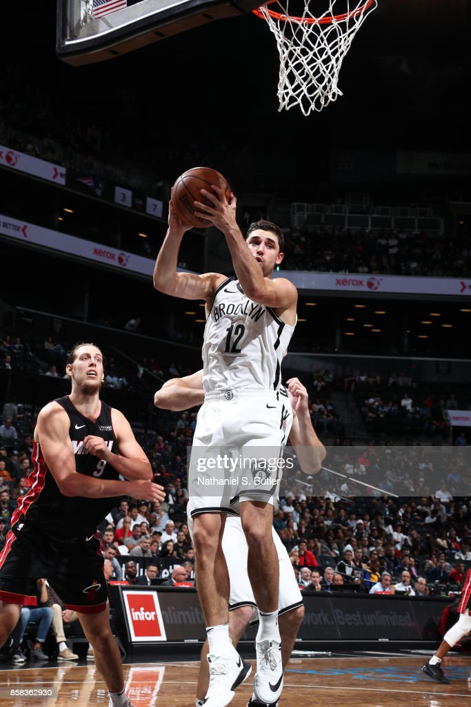 Joe Harris #12 of the Brooklyn Nets grabs the rebound against the Miami Heat during a preseason game on October 5, 2017 at Barclays Center in Brooklyn, New York.