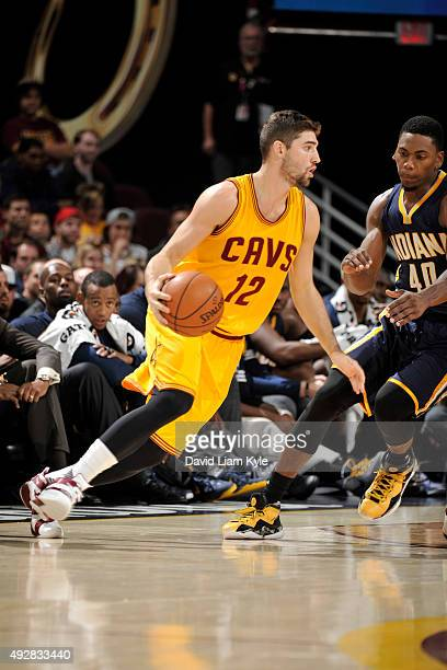 Joe Harris of the Cleveland Cavaliers dribbles the ball against the Indiana Pacers on October 15 2015 at Quicken Loans Arena in Cleveland Ohio NOTE...