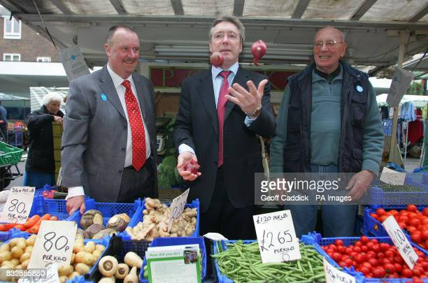 Joe Harrison President of the National Market Traders Federation with the Minister for Skills Phil Hope and fruit and veg market stall owner Charlie...