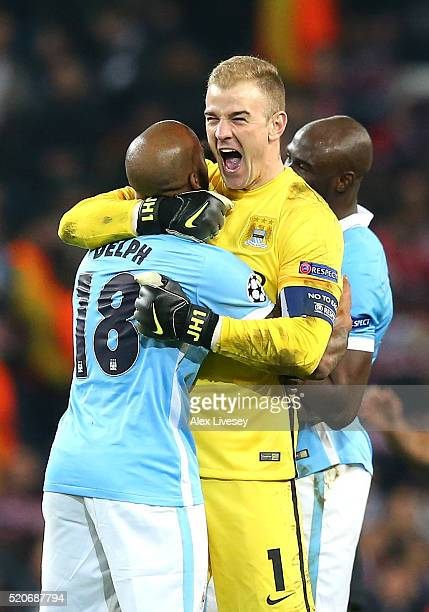 Joe Hart and Fabian Delph of Manchester City celebrate victory and reaching the semifinals after the UEFA Champions League quarter final second leg...