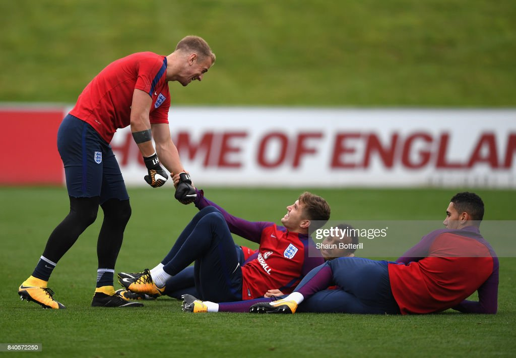 Joe Hart and John Stones share a joke during a England training session ahead of their World Cup Qualifiers against Malta and Slovakia at St Georges Park on August 29, 2017 in Burton-upon-Trent, England.