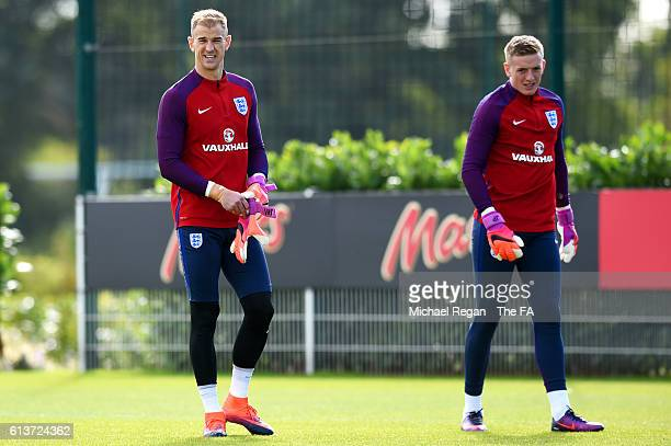 Joe Hart and Jordan Pickford look on during an England training session at the Tottenham Hotspur training ground on October 10 2016 in Enfield England