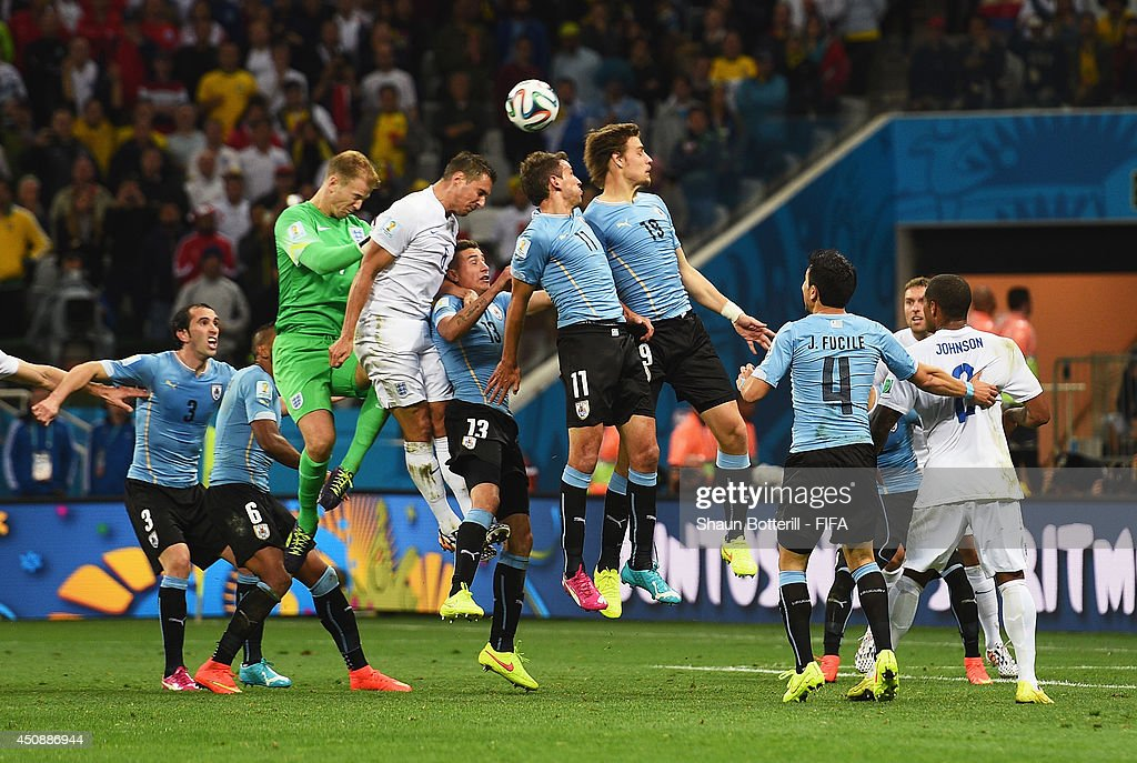 Joe Hart and Phil Jagielka of England, Christian Stuani and Sebastian Coates of Uruguay compete for the ball during the 2014 FIFA World Cup Brazil Group D match between Uruguay and England at Arena de Sao Paulo on June 19, 2014 in Sao Paulo, Brazil.