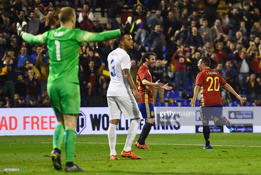 Joe Hart (1) and Ryan Bertrand of England (3) react as Santi Cazorla of Spain (20) celebrates with Juan Mata as he scores their second goal during the international friendly match between Spain and England at Jose Rico Perez Stadium on November 13, 2015 in Alicante, Spain.