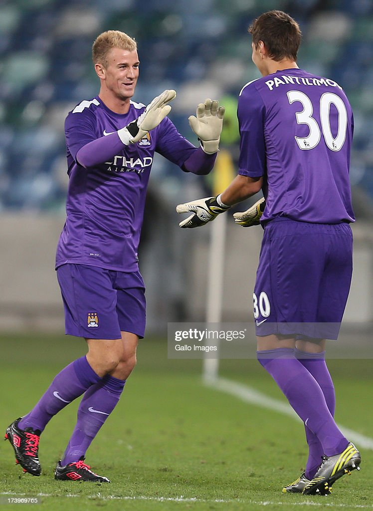 Joe Hart Goalkeeper of Manchester City off Costel Pantilimon Goalkeeper of Manchester City on during the Nelson Mandela Football Invitational match between AmaZulu and Manchester City at Moses Mabhida Stadium on July 18, 2013 in Durban, South Africa.