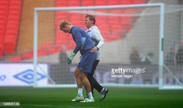 Joe Hart is taken off injured during the England training session at Wembley Stadium on November 16 2010 in London England