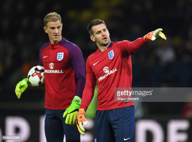 Joe Hart of England and Thomas Heaton of England speak while they warm up prior to the international friendly match between Germany and England at...