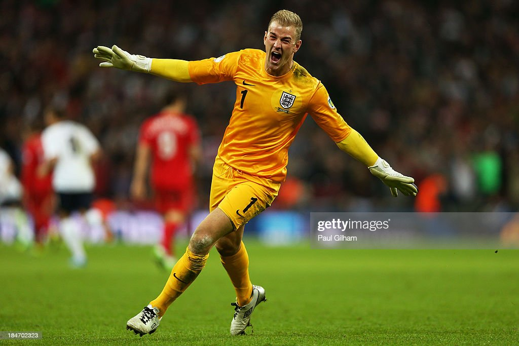 Joe Hart of England celebrates as Steven Gerrard of England scores their second goal during the FIFA 2014 World Cup Qualifying Group H match between England and Poland at Wembley Stadium on October 15, 2013 in London, England.