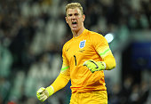Joe Hart of England celebrates his teammates goal during the international friendly match between Italy and England at Juventus Arena on March 31...