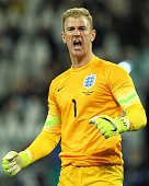 Joe Hart of England celebrates his teammates goal during the international friendly match between Italy and England at the Juventus Arena on March 31...