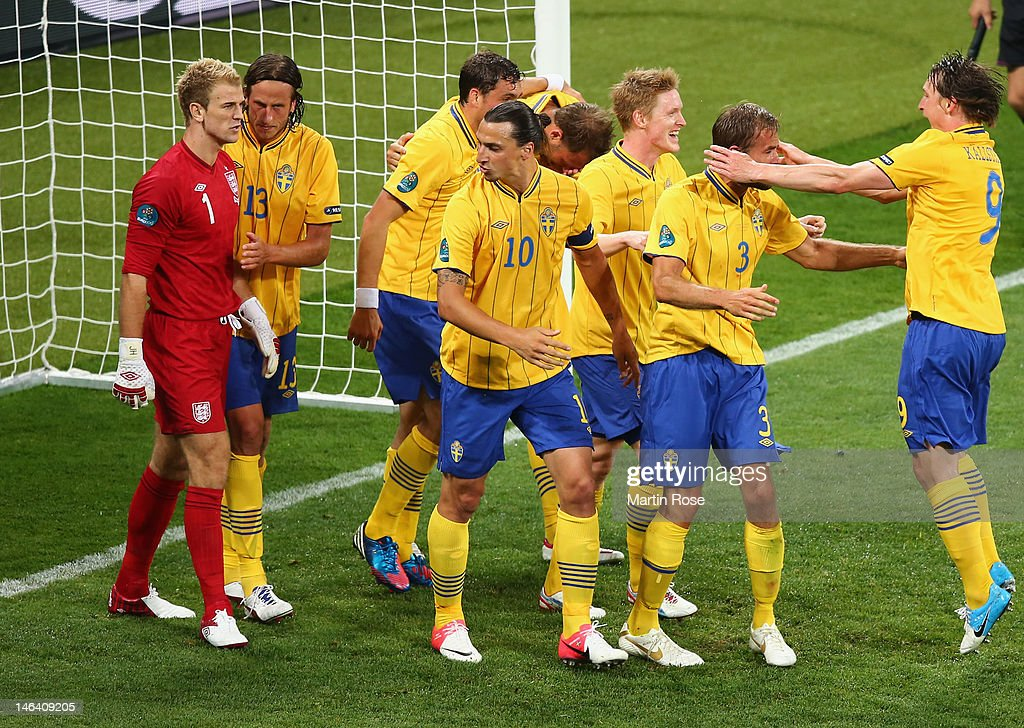 <a gi-track='captionPersonalityLinkClicked' href=/galleries/search?phrase=Joe+Hart&family=editorial&specificpeople=1295472 ng-click='$event.stopPropagation()'>Joe Hart</a> of England clashes with <a gi-track='captionPersonalityLinkClicked' href=/galleries/search?phrase=Zlatan+Ibrahimovic&family=editorial&specificpeople=206139 ng-click='$event.stopPropagation()'>Zlatan Ibrahimovic</a> of Sweden (10) as <a gi-track='captionPersonalityLinkClicked' href=/galleries/search?phrase=Olof+Mellberg&family=editorial&specificpeople=215028 ng-click='$event.stopPropagation()'>Olof Mellberg</a> (2R) scores their second goal during the UEFA EURO 2012 group D match between Sweden and England at The Olympic Stadium on June 15, 2012 in Kiev, Ukraine.