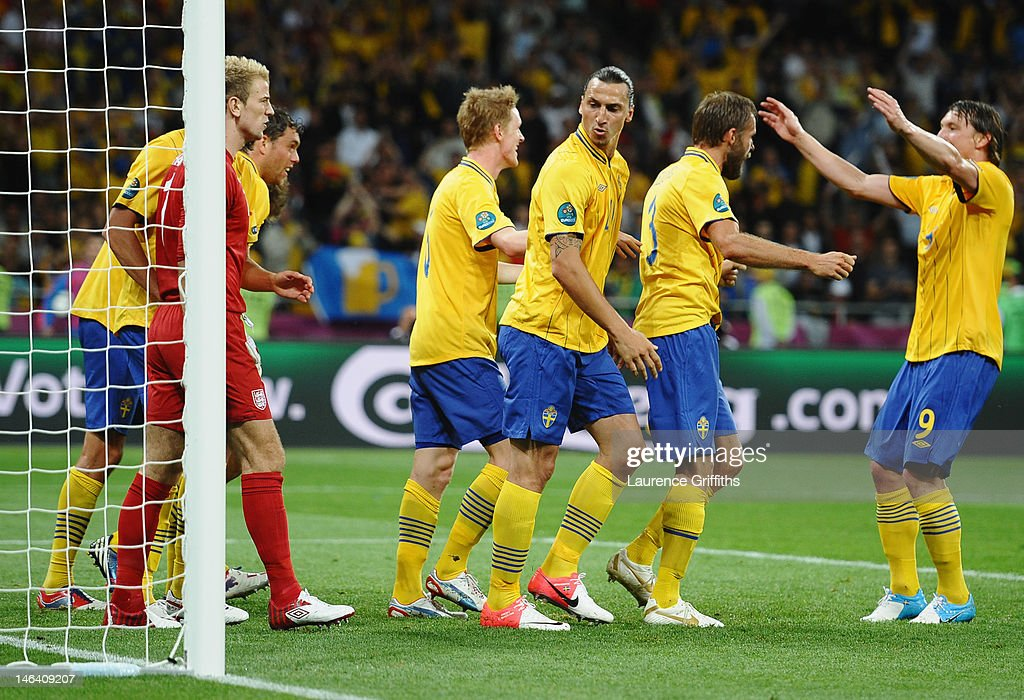 <a gi-track='captionPersonalityLinkClicked' href=/galleries/search?phrase=Joe+Hart&family=editorial&specificpeople=1295472 ng-click='$event.stopPropagation()'>Joe Hart</a> of England clashes with <a gi-track='captionPersonalityLinkClicked' href=/galleries/search?phrase=Zlatan+Ibrahimovic&family=editorial&specificpeople=206139 ng-click='$event.stopPropagation()'>Zlatan Ibrahimovic</a> of Sweden (3R) as <a gi-track='captionPersonalityLinkClicked' href=/galleries/search?phrase=Olof+Mellberg&family=editorial&specificpeople=215028 ng-click='$event.stopPropagation()'>Olof Mellberg</a> (2R) scores their second goal during the UEFA EURO 2012 group D match between Sweden and England at The Olympic Stadium on June 15, 2012 in Kiev, Ukraine.