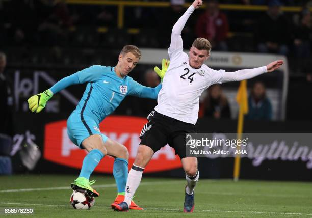 Joe Hart of England competes with Timo Werner of Germany during the international friendly match between Germany and England at Signal Iduna Park on...
