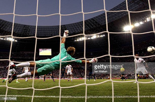 Joe Hart of England dives to make a save during the UEFA EURO 2012 group D match between France and England at Donbass Arena on June 11 2012 in...