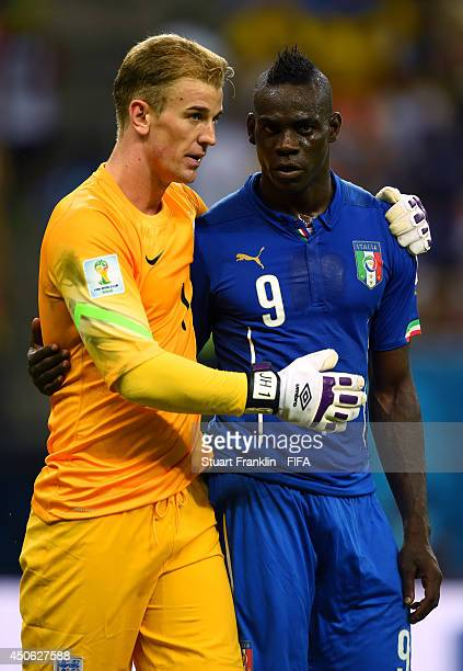 Joe Hart of England greets Mario Balotelli of Italy during the 2014 FIFA World Cup Brazil Group D match between England and Italy at Arena Amazonia...