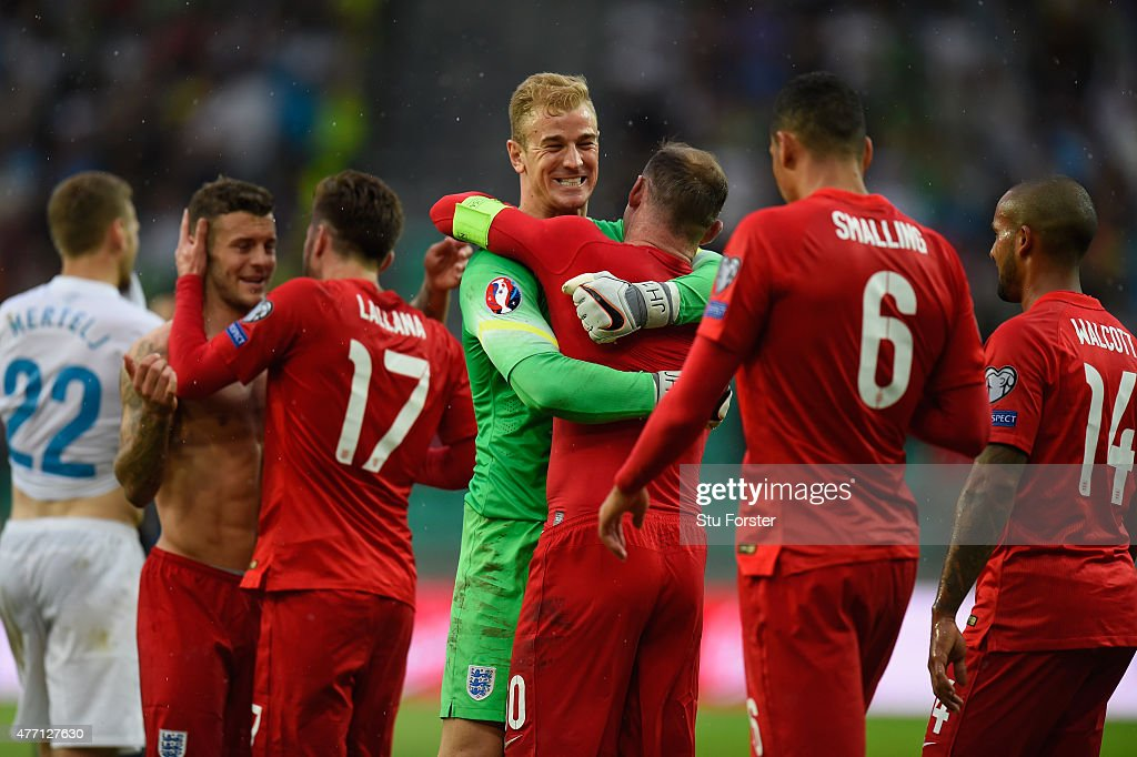 Joe Hart of England hugs Wayne Rooney of England after victory in the UEFA EURO 2016 Qualifier between Slovenia and England on at the Stozice Arena...