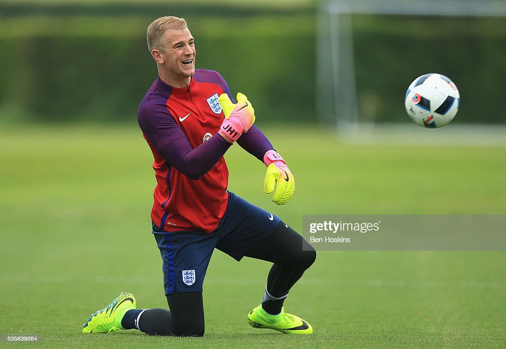 <a gi-track='captionPersonalityLinkClicked' href=/galleries/search?phrase=Joe+Hart&family=editorial&specificpeople=1295472 ng-click='$event.stopPropagation()'>Joe Hart</a> of England in good spirits during an England training session at London Colney on May 30, 2016 near St Albans, England.