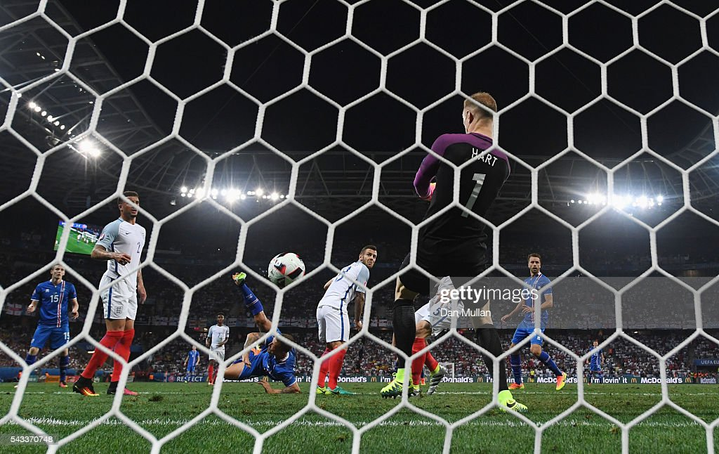Joe Hart of England makes a save an overhead shot by Ragnar Sigurdsson of Iceland during the UEFA EURO 2016 round of 16 match between England and Iceland at Allianz Riviera Stadium on June 27, 2016 in Nice, France.