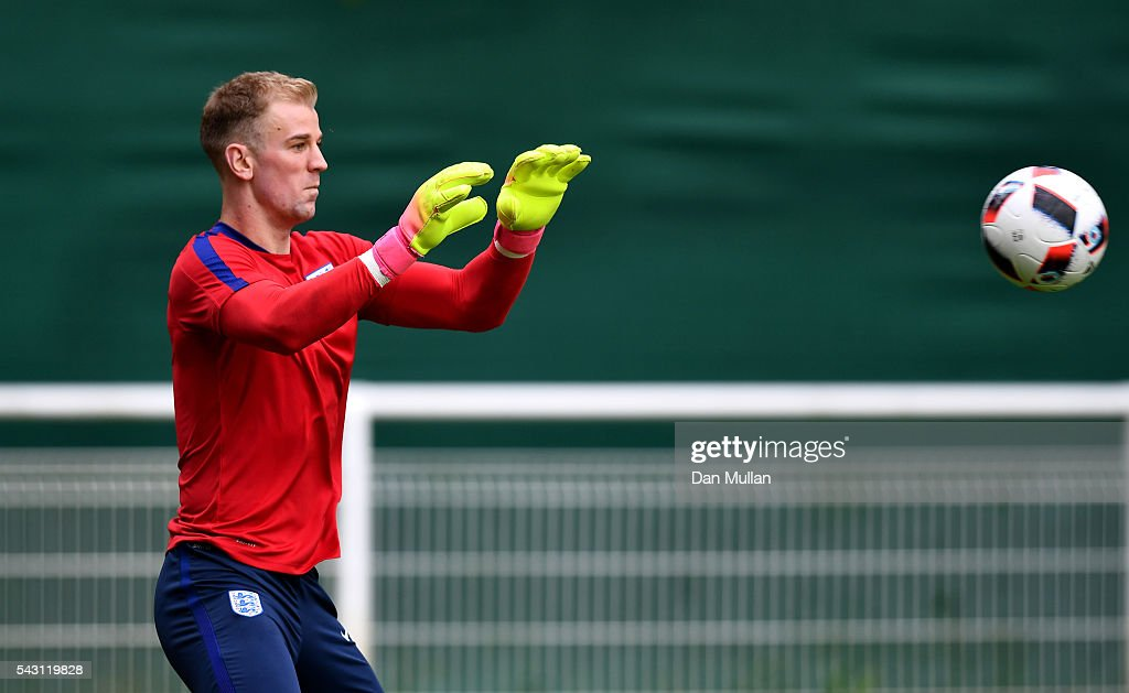 <a gi-track='captionPersonalityLinkClicked' href=/galleries/search?phrase=Joe+Hart&family=editorial&specificpeople=1295472 ng-click='$event.stopPropagation()'>Joe Hart</a> of England makes a save during a training session ahead of the UEFA Euro 2016 match against Iceland at Stade du Bourgognes on June 26, 2016 in Chantilly, France.