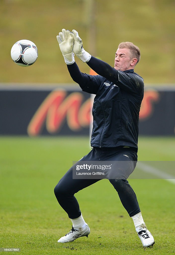 <a gi-track='captionPersonalityLinkClicked' href=/galleries/search?phrase=Joe+Hart&family=editorial&specificpeople=1295472 ng-click='$event.stopPropagation()'>Joe Hart</a> of England saves a ball during a training session at St Georges Park on March 19, 2013 in Burton-upon-Trent, England.