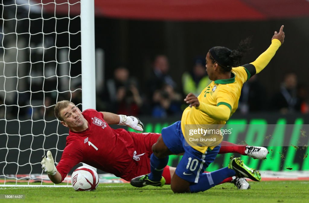 <a gi-track='captionPersonalityLinkClicked' href=/galleries/search?phrase=Joe+Hart&family=editorial&specificpeople=1295472 ng-click='$event.stopPropagation()'>Joe Hart</a> of England saves a penalty from <a gi-track='captionPersonalityLinkClicked' href=/galleries/search?phrase=Ronaldinho&family=editorial&specificpeople=202667 ng-click='$event.stopPropagation()'>Ronaldinho</a> of Brazil during the International friendly between England and Brazil at Wembley Stadium on February 6, 2013 in London, England.