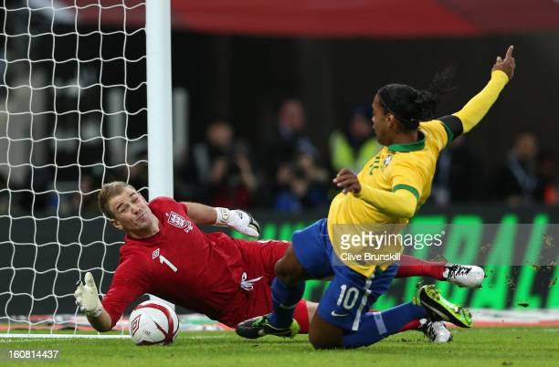 Joe Hart of England saves a penalty from Ronaldinho of Brazil during the International friendly between England and Brazil at Wembley Stadium on...