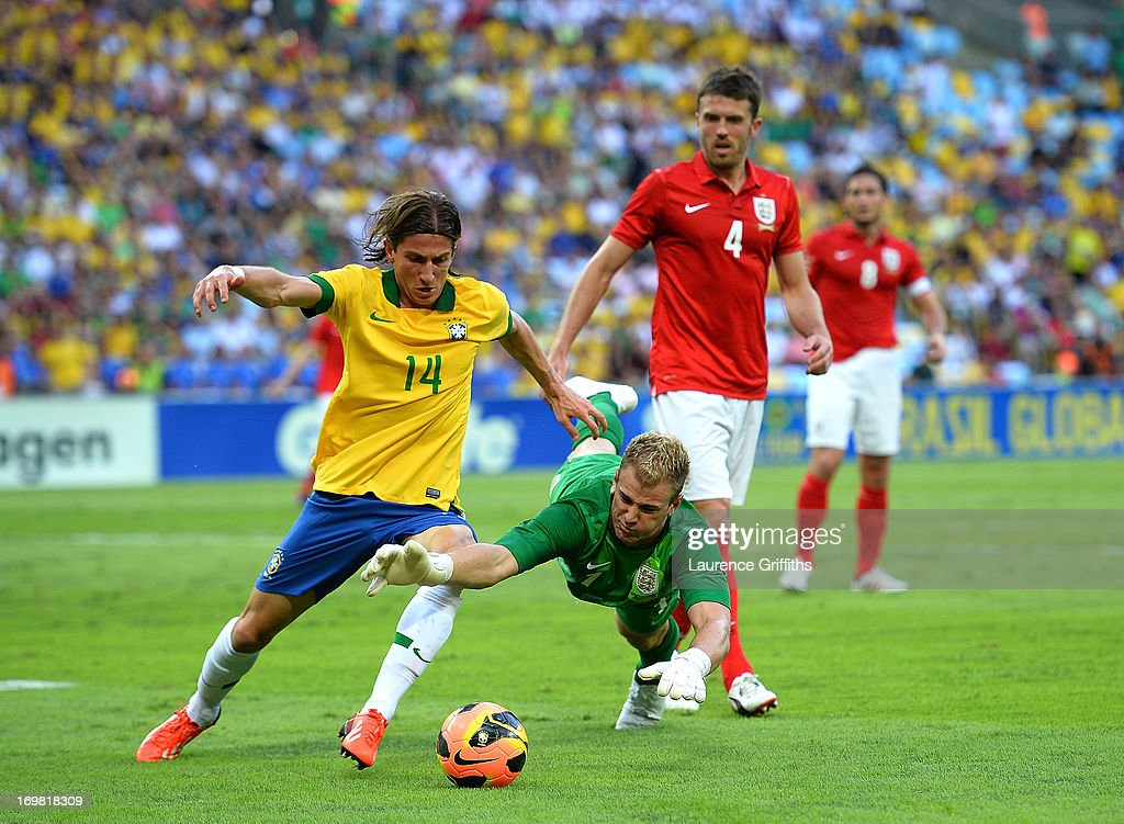 <a gi-track='captionPersonalityLinkClicked' href=/galleries/search?phrase=Joe+Hart&family=editorial&specificpeople=1295472 ng-click='$event.stopPropagation()'>Joe Hart</a> of England saves at the feet of <a gi-track='captionPersonalityLinkClicked' href=/galleries/search?phrase=Filipe+Luis&family=editorial&specificpeople=3941966 ng-click='$event.stopPropagation()'>Filipe Luis</a> during the International Friendly match between England and Brazil at Maracana on June 2, 2013 in Rio de Janeiro, Brazil.