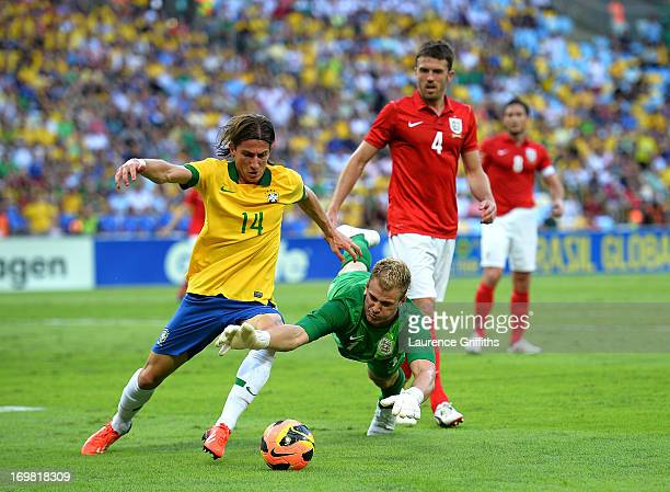Joe Hart of England saves at the feet of Filipe Luis during the International Friendly match between England and Brazil at Maracana on June 2 2013 in...