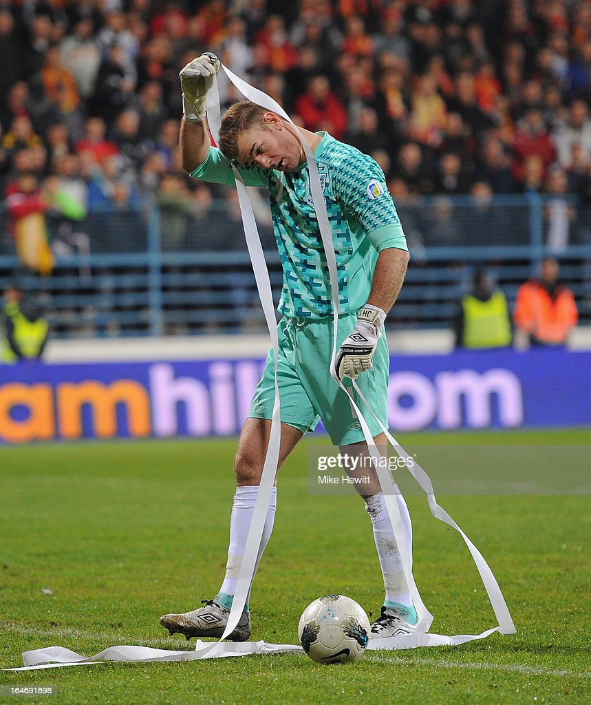 Joe Hart of England untangles a toilet roll from his head during the FIFA 2014 World Cup Group H Qualifier between Montenegro and England at City Stadium on March 26, 2013 in Podgorica, Montenegro.