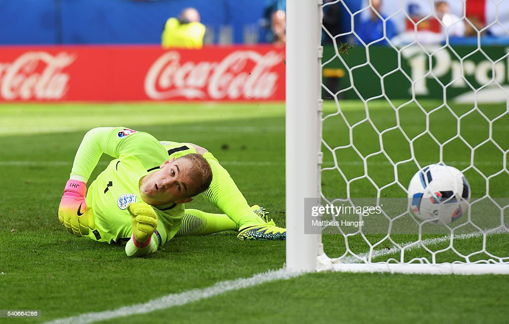 <a gi-track='captionPersonalityLinkClicked' href=/galleries/search?phrase=Joe+Hart&family=editorial&specificpeople=1295472 ng-click='$event.stopPropagation()'>Joe Hart</a> of England watches the ball as Gareth Bale of Wales scores his team's first goal during the UEFA EURO 2016 Group B match between England and Wales at Stade Bollaert-Delelis on June 16, 2016 in Lens, France.
