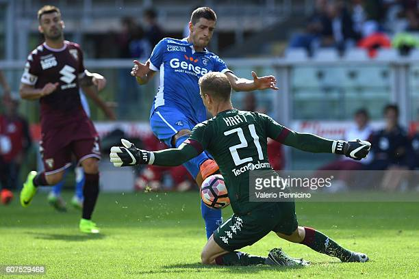 Joe Hart of FC Torino in action against Manuel Pucciarelli of Empoli FC during the Serie A match between FC Torino and Empoli FC at Stadio Olimpico...