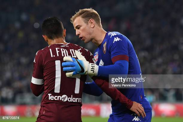 Joe Hart of FC Torino issues instructions his team mate Iago Falque during the Serie A match between Juventus FC and FC Torino at Juventus Stadium on...