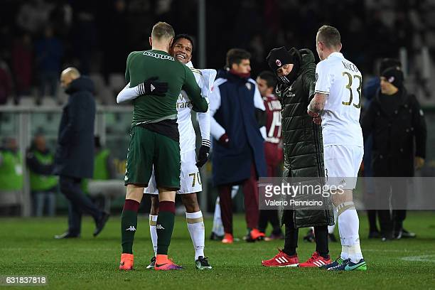 Joe Hart of FC Torino salutes Carlos Bacca of AC Milan at the end of the Serie A match between FC Torino and AC Milan at Stadio Olimpico di Torino on...