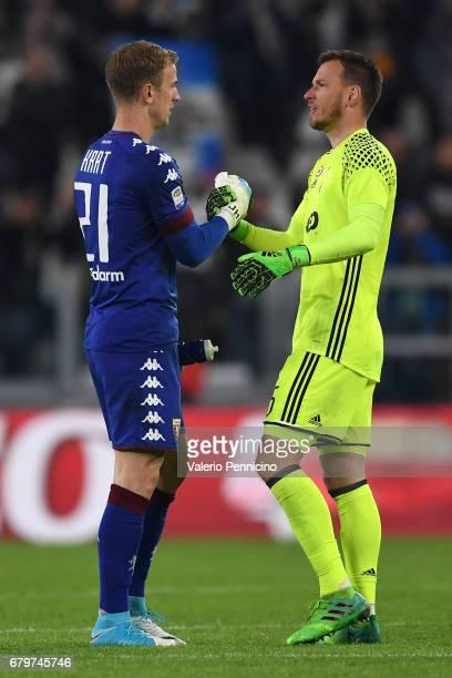 Joe Hart of FC Torino salutes Norberto Murara Neto of Juventus FC at the and of the Serie A match between Juventus FC and FC Torino at Juventus...