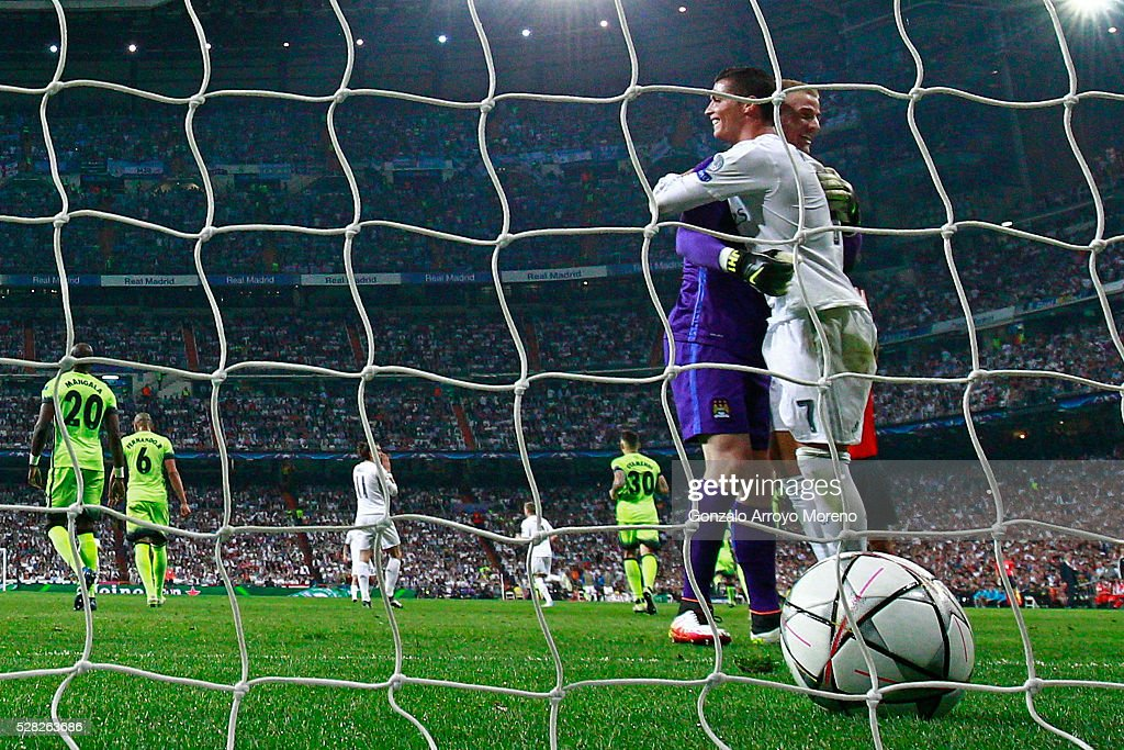 Joe Hart of Manchester City and Cristiano Ronaldo of Real Madrid share a moment during the UEFA Champions League semi final, second leg match between Real Madrid and Manchester City FC at Estadio Santiago Bernabeu on May 4, 2016 in Madrid, Spain.