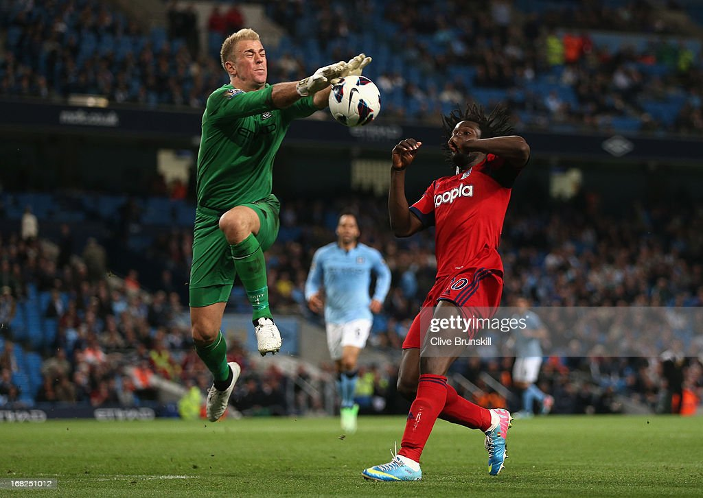 <a gi-track='captionPersonalityLinkClicked' href=/galleries/search?phrase=Joe+Hart&family=editorial&specificpeople=1295472 ng-click='$event.stopPropagation()'>Joe Hart</a> of Manchester City blocks the attempt on goal of Youssouf Mulumbu of West Bromwich Albion during the Barclays Premier League match between Manchester City and West Bromwich Albion at the Etihad Stadium on May 07, 2013 in Manchester, England.
