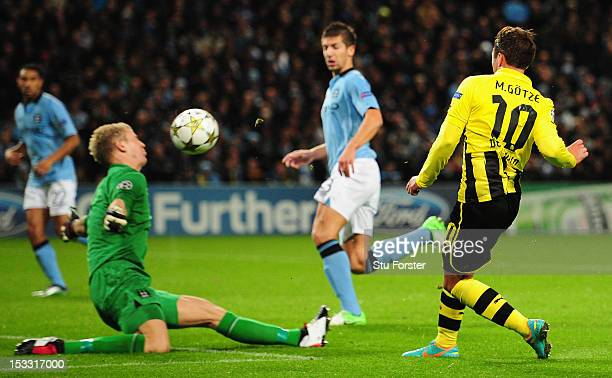Joe Hart of Manchester City blocks the shot of Mario Gotze of Borussia Dortmund during the UEFA Champions League Group D match between Manchester...