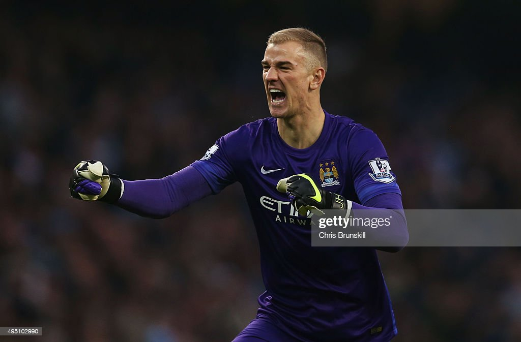 Joe Hart of Manchester City celeberate his team's first goal by Nicolas Otamendi (not pictured) during the Barclays Premier League match between Manchester City and Norwich City at Etihad Stadium on October 31, 2015 in Manchester, England.