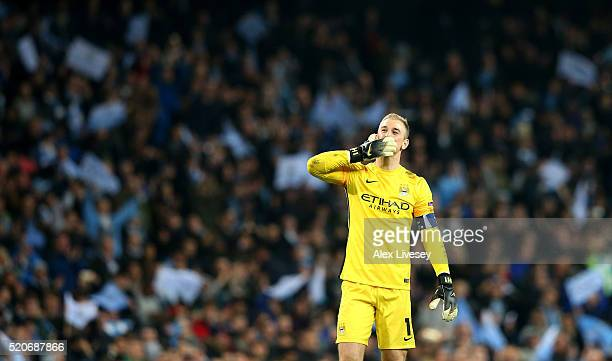 Joe Hart of Manchester City celebrates victory and reaching the semifinals after the UEFA Champions League quarter final second leg match between...