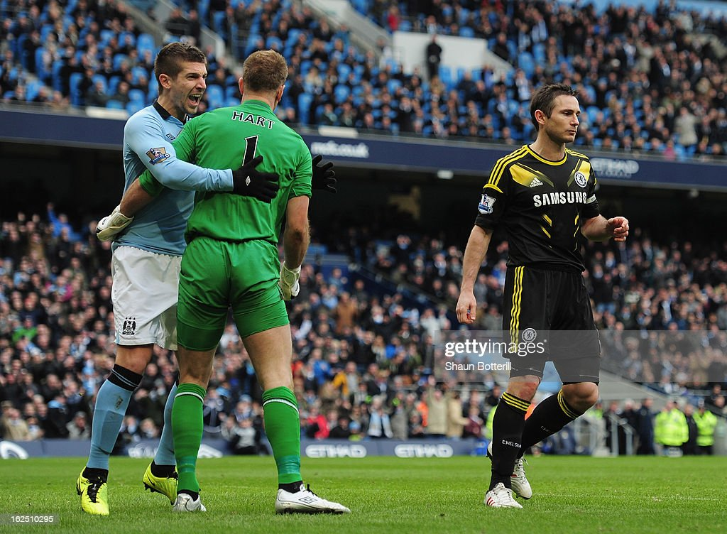 Joe Hart of Manchester City celebrates with Matija Nastasic after saving a penalty from Frank Lampard of Chelsea penalty during the Barclays Premier League match between Manchester City and Chelsea at Etihad Stadium on February 24, 2013 in Manchester, England.