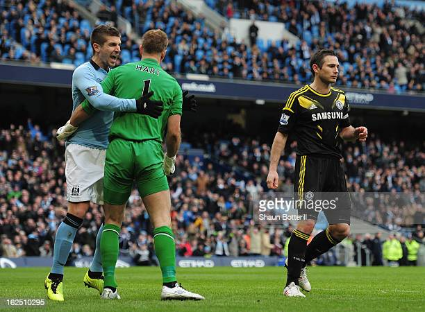Joe Hart of Manchester City celebrates with Matija Nastasic after saving a penalty from Frank Lampard of Chelsea penalty during the Barclays Premier...